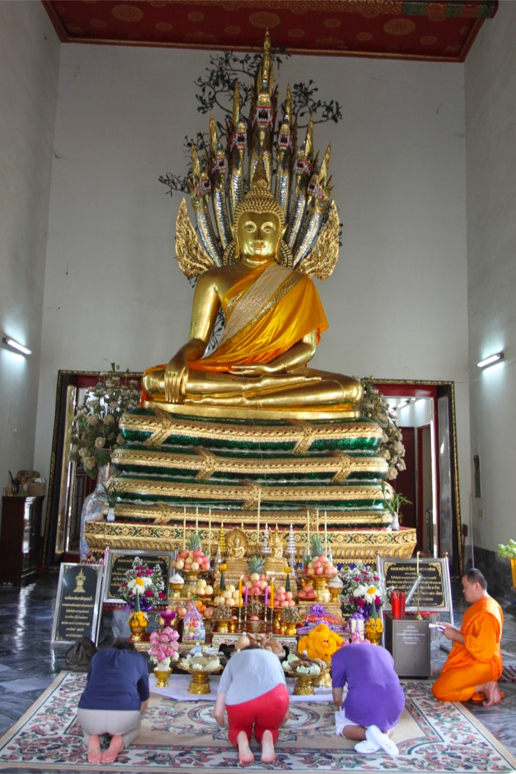 People at prayer, Wat Pho, Bangkok, Thailand