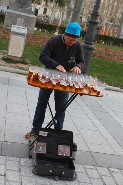 Man plays glasses, Madrid, Spain