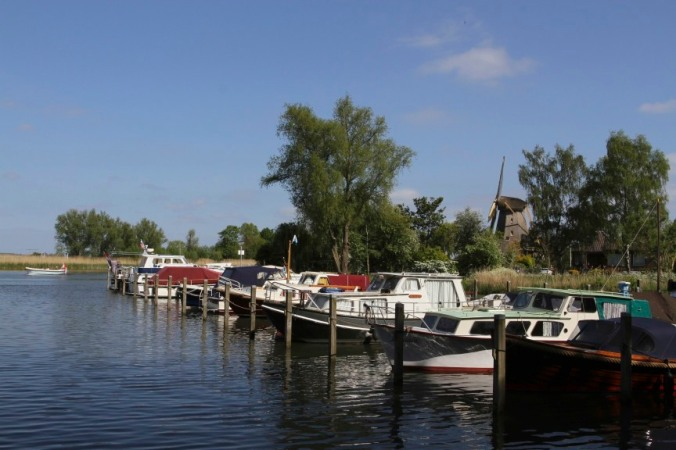 Windmills and boats on the River Vecht, Weesp, Netherlands
