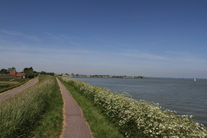 Cycling along the IJsselmeer near Volendam, Netherlands