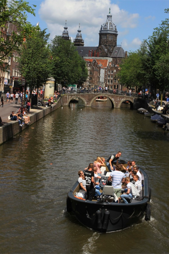 Canals and party boat, Amsterdam, Netherlands