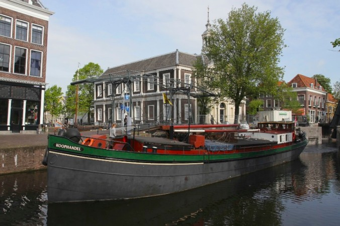 Boats passing down the main canal, Schiedam, Netherlands