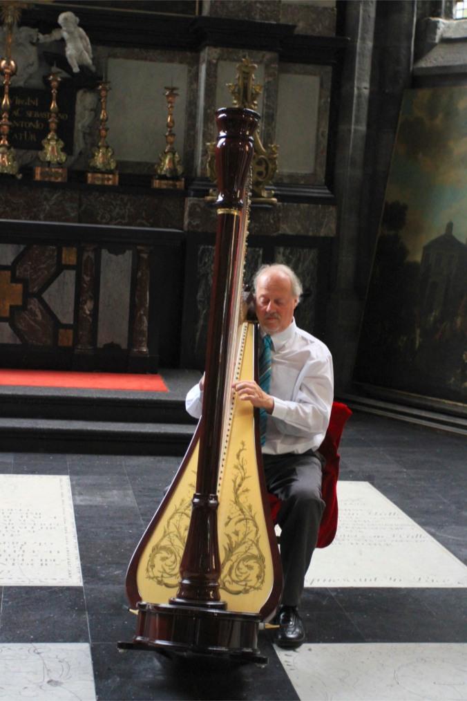 Harp player in Sint-Baafskathedraal, Ghent, Belgium