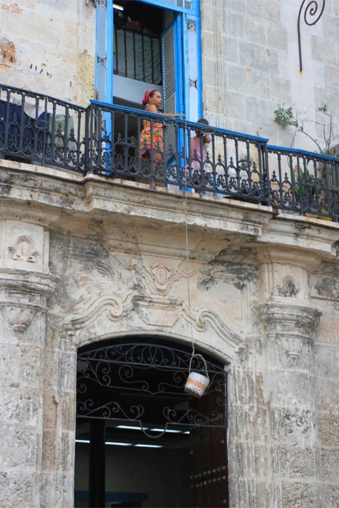 Lowering a basket, Havana Vieja, Cuba