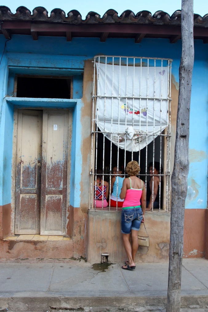 Women talk at a window, Trinidad, Cuba