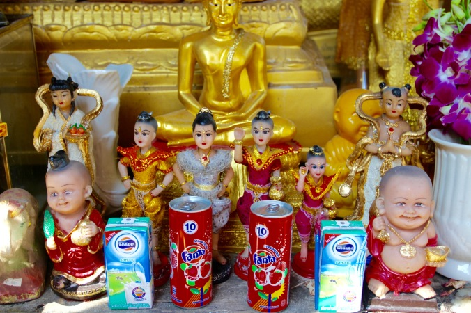 Offerings at a Buddhist temple, Bangkok, Thailand