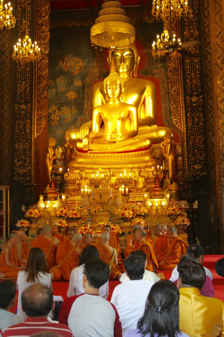Monks at prayer, Wat Bowonniwet Vihara, Bangkok, Thailand