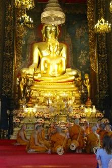 Monks at prayer, Wat Bowonniwet Vihara, Bangkok, Thailand