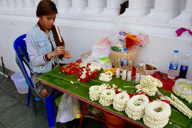 Flowers being prepared at a Buddhist temple, Bangkok, Thailand