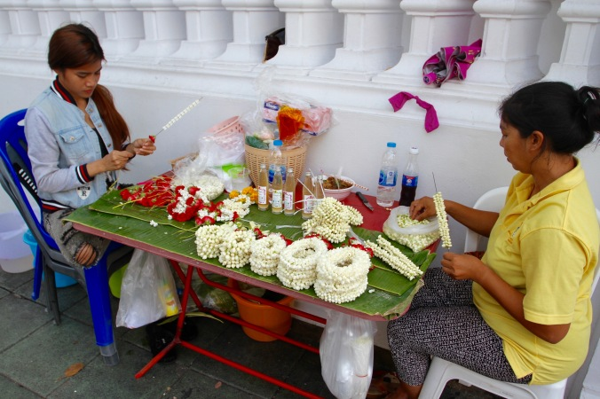 Making floral offerings, Buddhist temple, Bangkok, Thailand