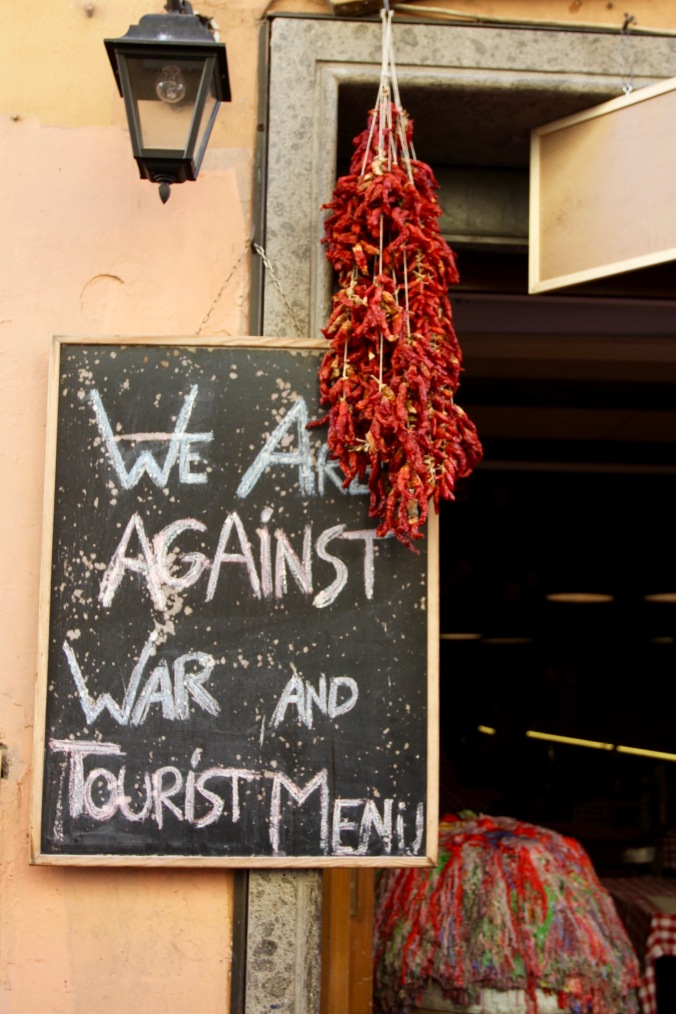 We are against war and tourist menu, Rome, Italy