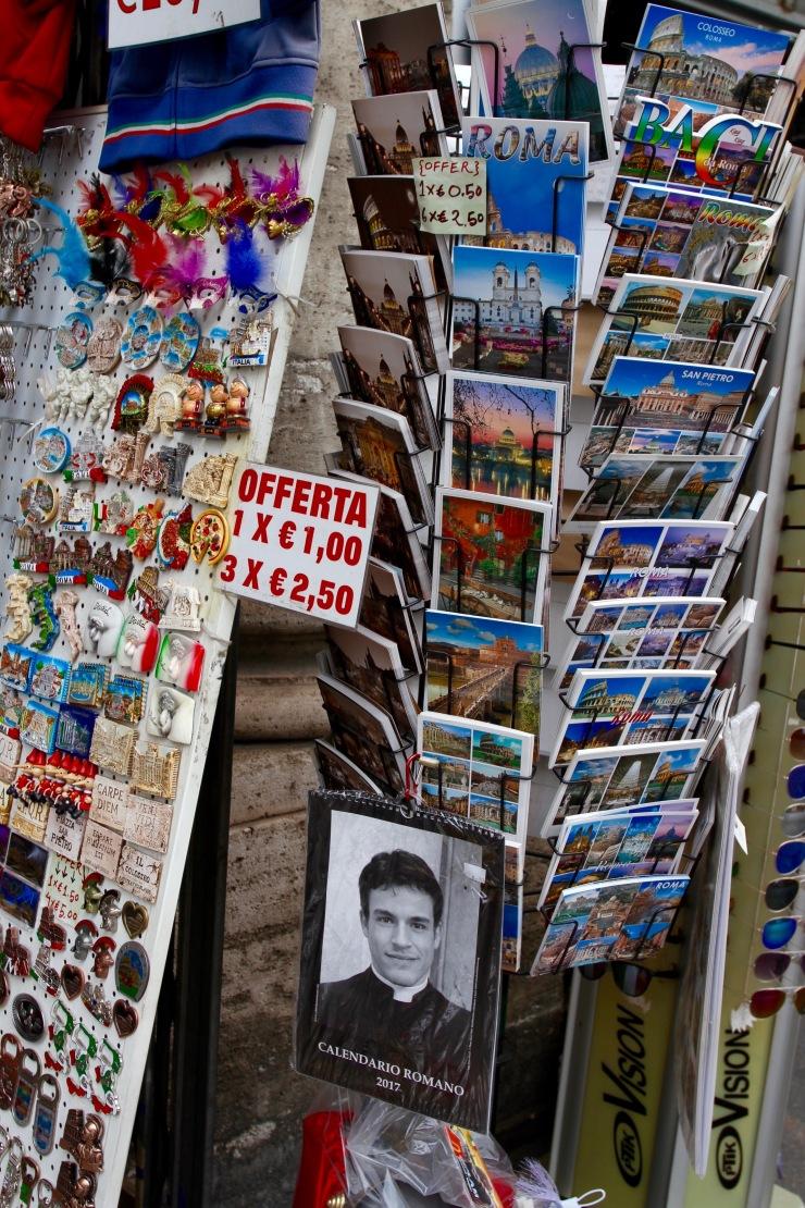Tourist tat and hot priest calendar, Rome, Italy