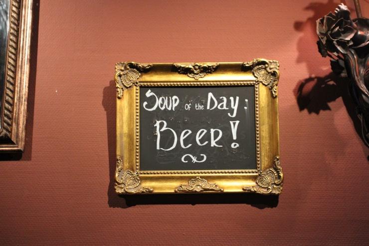 Sign in the Cafe Red Rose, Bruges, Belgium
