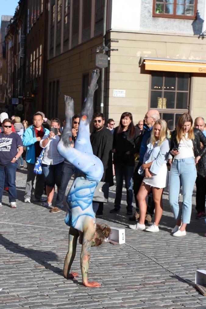 Painted performer, Stortorget, Gamla Stan, Stockholm, Sweden