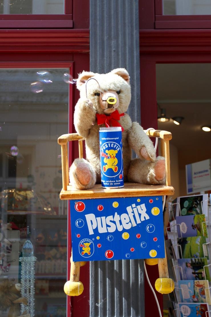 Bear blowing bubbles, Schwerin, Germany