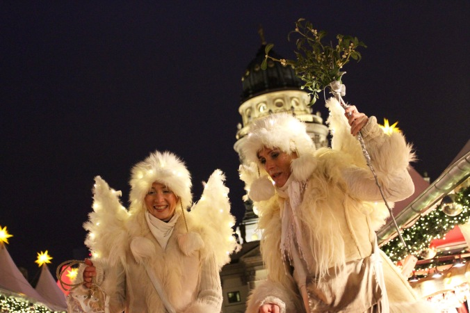 Stilt walkers, Gendarmenmarkt Xmas Market, Berlin, Germany