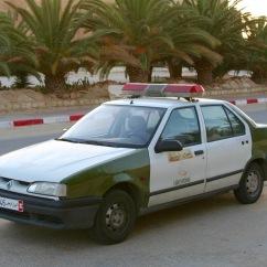Police car and taxi, Douz, Tunisia